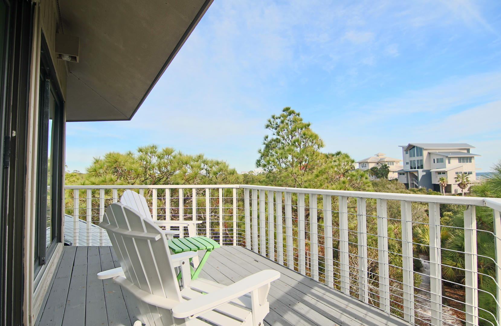 Enjoy the breeze and views while lounging on this second level deck.