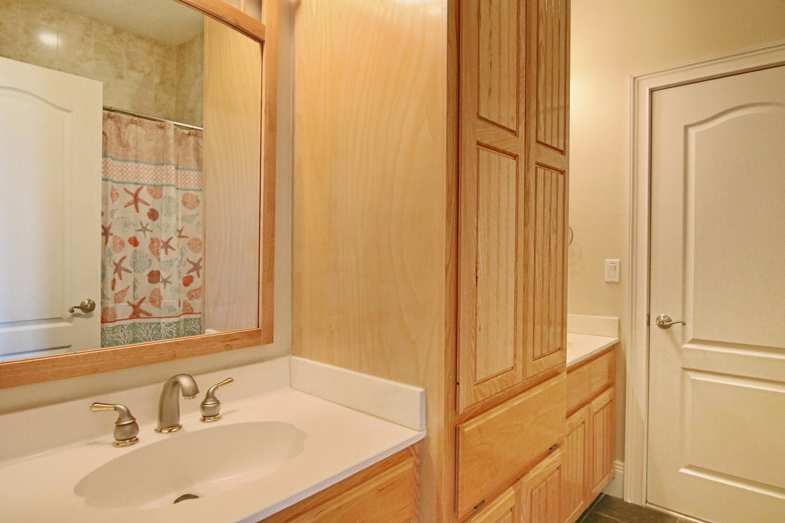 Shared Jack and Jill bath located off the first level den and second King Suite