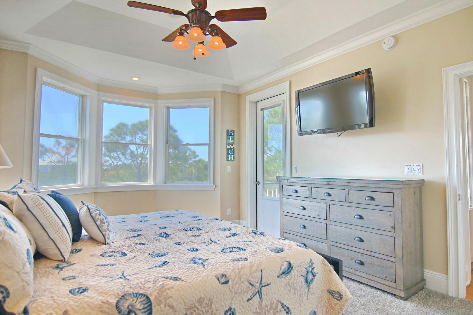 The master King Suite offers beautiful views and access to the shared deck.