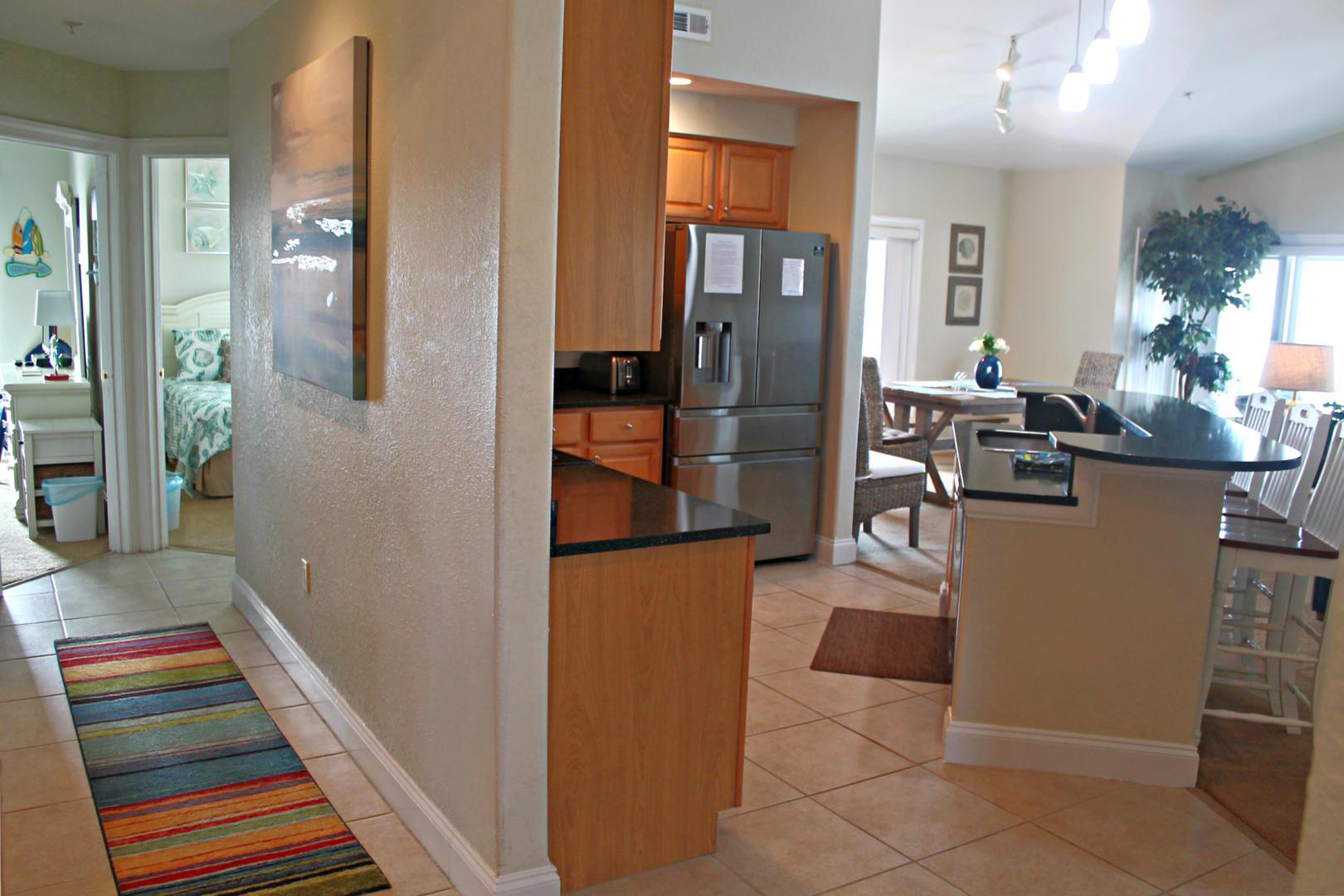 4100 Oceanside Condos 405 - Hallway and Kitchen
