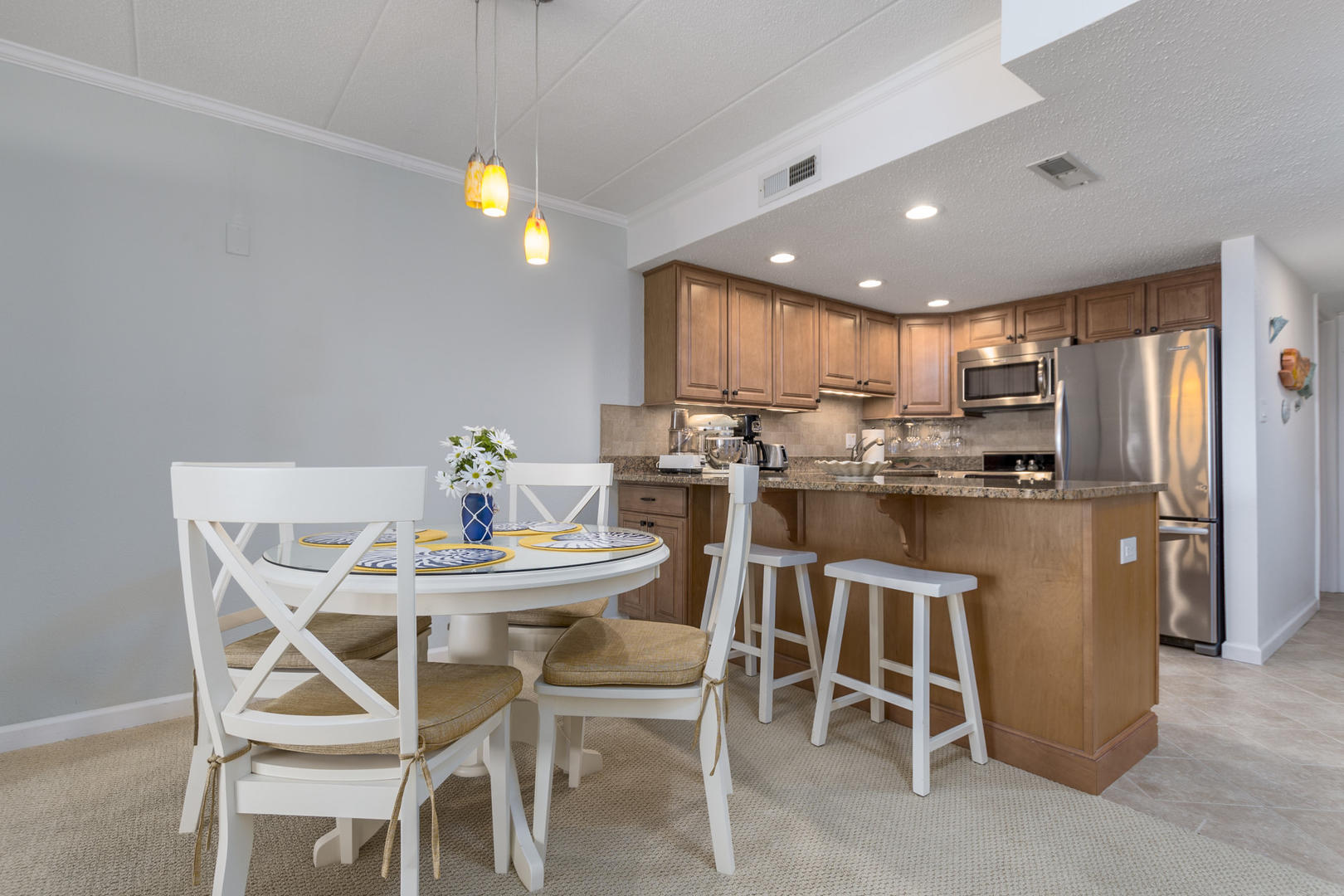Pelican Beach 102 - Kitchen and Dining Area