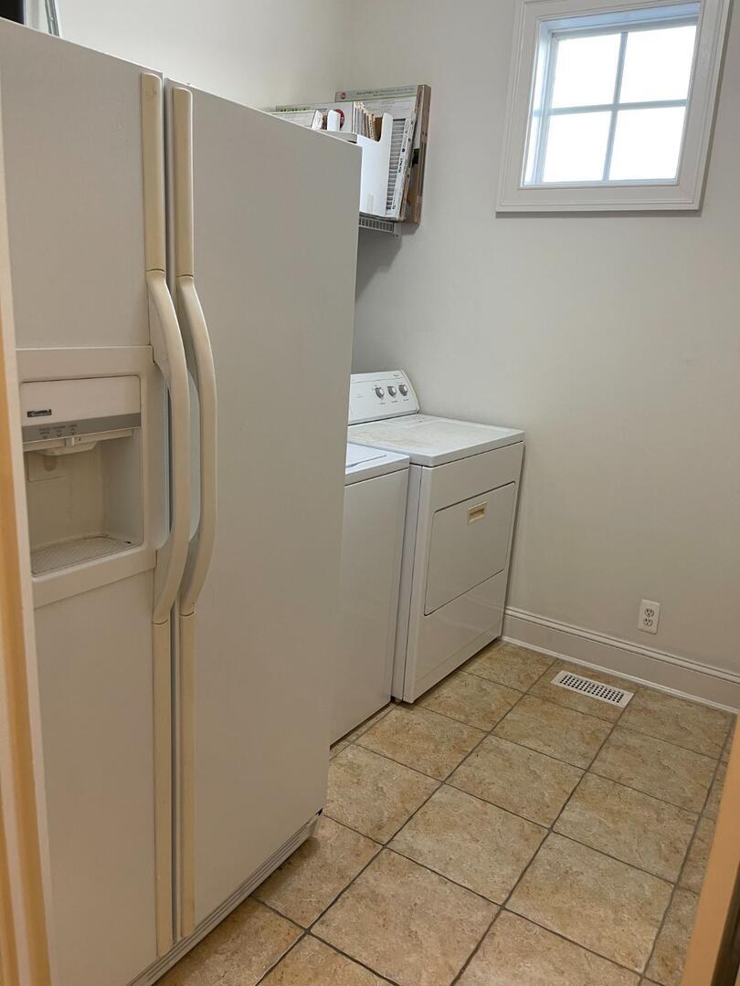 2nd Floor Laundry and Extra Refrigerator - Sunset Island 55 Island Edge Dr.